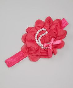 More than just a way to keep stray strands at bay, this headband will elevate any lovely look to new heights. With a bright bloom, pearls and bitty bow topped on a stretchy band, this piece is as comfy as it is couture.