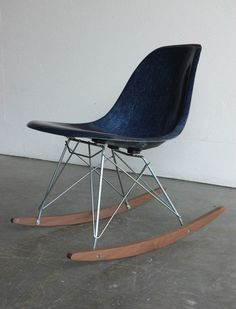 Herman Miller Eames Rocker.  I don't know about you, but I think these chairs are perfect for popping backs!