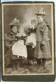 Antique 1900 photo girl with two Patent Washable Papier Mache dolls