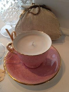 Candle in a vintage tea cup