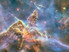 Mystic Mountain  Hubble's 20th anniversary image shows a mountain of dust and gas rising in the Carina Nebula. The top of a three-light-year tall pillar of cool hydrogen is being worn away by the radiation of nearby stars, while stars within the pillar unleash jets of gas that stream from the peaks.