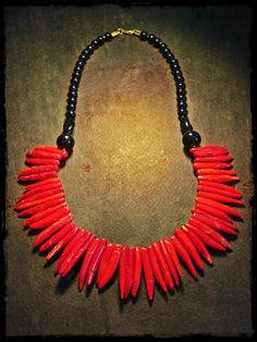 handmade necklace made of coral semi-precious gemstones and black beads