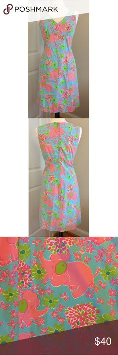Lilly Pulitzer shift dress with elephant print Aqua with pink elephants and green and pink floral motif. Fitted shift silhouette with V-neck and zip back. Size 12. Measurements available upon request. 100% cotton with 65% polyester/35% cotton lining. Excellent used condition. Lilly Pulitzer Dresses Mini