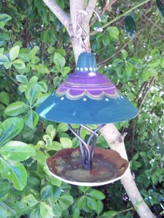 Upcycled bird feeder made from decorative plate and lamp parts