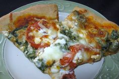 Spinach Feta and Artichoke Pizza I'm making this tonight with whole wheat crust and fresh spinach @glassheartgirl