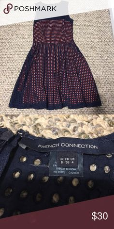 """French Connection dress navy blue 4 French Connection dress. Navy blue with orange cotton lining sheering through the net looking top layer. Size 4. Zipper back. EUC. Pockets on both sides of skirt in the seams. No defects. Worn once or twice. Length 36"""". Pit to pit 17"""" , gives a little bit of stretch if needed. French Connection Dresses Midi"""