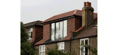 IQ designed and installed various glazed elements throughout this London home, including a frameless glass balustrade, frameless sliding doors and structural glass walls Frameless Glass Balustrade, Rear Extension, Sliding Doors, Extensions, Loft, London, Contemporary, Mansions, House Styles