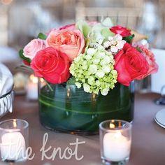 Centre de table corail pour décorer votre table de mariage