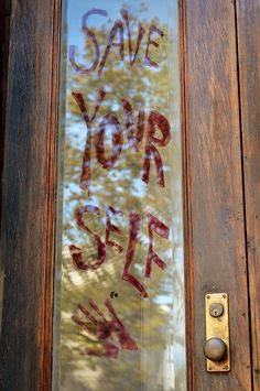 "MOVIE NIGHT: ""Save Yourself""   Frightful Door Greeting Idea.....Corn syrup + red food dye = scary writing that comes off easily.   If you dare, Beware......Eeek !"