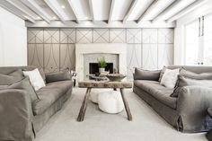 """The family room connects with the Whites' kitchen and features an entire wall of upholstered cabinetry that conceals everything from children's toys to their 55"""" TV."""