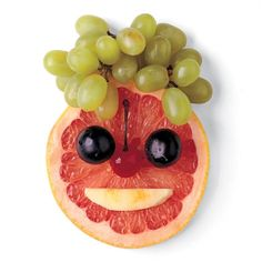 What a fun way to enjoy fruit!  Grapefruit face with grapes, a cherry, and a banana. #healthysnacks