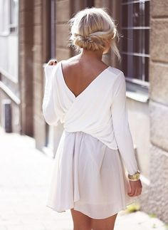 White on white, draped back with a hint of gold. Low and messy wrapped under bun.