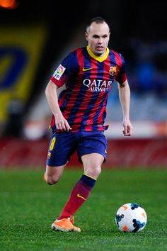 Andres Iniesta of FC Barcelona runs with the ball during the La Liga match between Real Sociedad and FC Barcelona at Estadio Anoeta on February 22, 2014 in San Sebastian, Spain.