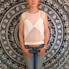 Chic Tank Top White tank top with sheer cut outs. Never worn. H&M Tops Tank Tops