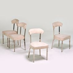 Set of four side chairs, 1920s; Heavy chromed steel, ultrasuede