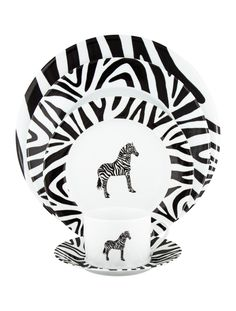 15-piece black and white Limoges porcelain Patricia Deroubaix tableware set with zebra motifs throughout and brand stamps at undersides. Includes 2 service plates, 3 dinner plates, 2 salad plates, 4 teacups and 4 saucers. Salad Plates, Dinner Plates, Dinnerware, Tea Cups, Decorative Plates, Porcelain, Tableware, Stamps, Collections