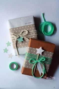 simple Christmas wrapping - kraft paper, polka dot paper, yarn, and stars