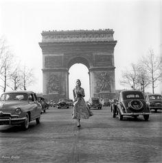 Givenchy model on Les Champs-Elysées, Paris, 1953 ♦ by Pierre Boulat