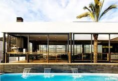 palm trees near contemporary two storey house - Google Search