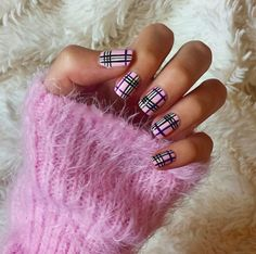 Up your nail art game with a mani in pink plaid.