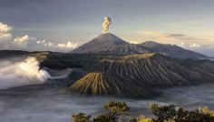 Mount Bromo is an active volcano located in East Java, Indonesia. At feet meters) high, the volcano and its smokey sulfuric cloud can easily be seen from a distance. Lombok, Mountain Photography, Travel Photography, Volcano Pictures, Reserva Natural, Mountain Wallpaper, Original Travel, Travel Activities, Fun Activities