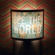 Turn off the lights and let the message of travel shine through. | 28 Inspiring Decor Ideas To Satisfy Your Wanderlust