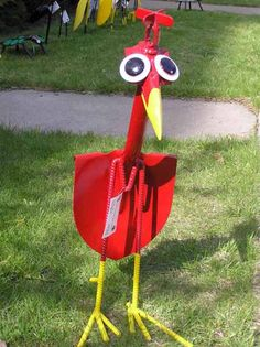 art made out of tools | Red bird made of old garden shovel, bright garden decorations for ...