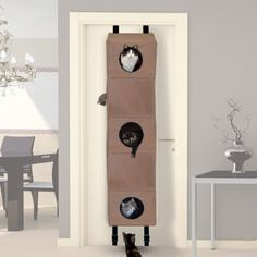 A one-of-a-kind playhouse where multiple cats can climb, play, and rough house. Space saving design attaches to a door.