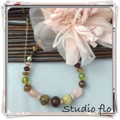 Short necklace in pink Quartz and rose gold finish ...a combination of soft colors and earth tone marble stones ... I had my inspiration from a bouquet of flowers at an early morning in Spring ...love this look , it will match with any pastel blouse . Facebook.com/studioflomonbijou