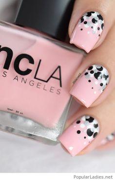 Light pink nail polish with polka dots