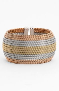 Wide Cuff (Nordstrom Exclusive). A contoured stack of twisted steel cables lends elegant strength to a wide cuff held together with solid-gold finishing touches.