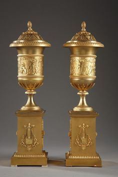 An exceptional pair of ormolu vases pot-pourri and candlestick with their openwork lids decorated with foliage and pinecone finial. Underneath, their socket is finely chiseled with grooves.