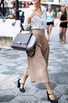 These might be a bit high for me, but I've always enjoyed mary janes. I don't care for the rest of the outfit though - too long skirt, button down blouse, and huge purse.