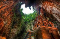 Temple Deep in the Caves Borneo, Indonesia  Read this article for some more Temple's : http://amazinglist.net/2013/02/balis-tanah-lot-sea-temple/