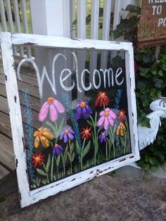 An old cottage screen is painted to use as hanging decor!