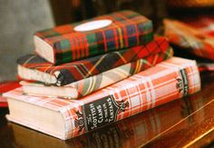 Wrap some books in tartan paper just to set a stack on shelves for Christmas in the family room. Lovely collection of vintage tartan books
