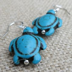 """These adorable turquoise turtle (""""turqu-les""""… get it?) earrings add a splash of colour to any outfit, and hang from silver-plated, nickel-free ear wires. Color Splash, Turquoise Bracelet, Jewelry Making, Paint Splats, Jewellery Making, Make Jewelry, Diy Jewelry Making"""