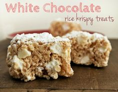 White Chocolate Rice Krispy Treats. Made with butter, white chocolate, marshmallows, vanilla, rice krispies, white chocolate chips, and powdered sugar.