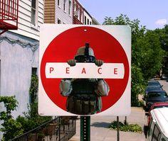 dan witz.  brilliant use of existing sign.