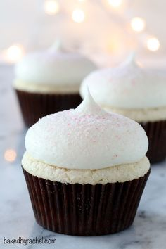 White chocolate cupcakes with white chocolate peppermint cream cheese frosting recipe from @bakedbyrachel