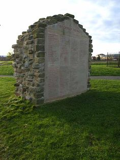 """This monument within the grounds of the Segedunum Museum commemorates the builders of the Wall. """"Builders of the Wall"""" by Oliver Dixon, geograph. At the eastern end of Hadrian's Wall & of Hadrians Wall National Trail which runs 135 km from Bowness-on-Solway to Wallsend."""