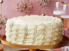 Eggnog Spice Cake with Bourbon Custard Filling and Eggnog Buttercream Recipe 🎂🍾🙆‍♀️ This towering four-layer cake is creamy and slightly boozy. Christmas Desserts, Christmas Baking, Holiday Cakes, Christmas Recipes, Christmas Cookies, Holiday Recipes, Christmas Foods, Christmas Ideas, Winter Desserts