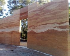 Multi coloured rammed earth wall. Noosa Pengari School Hall