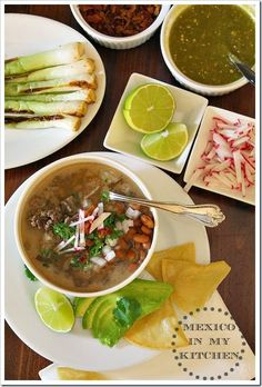 Carne en su Jugo - A Mexican concentrated flavorful broth of beef meat finely diced and served with beans plus a wide array of toppings served alongside.
