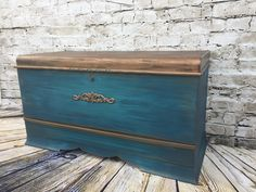 I did the top stained in kona with a copper wax on top. The body is a light teal with a dark teal glaze and copper for depth and interest. Done by Sensational Finds