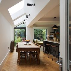 Window seat large single door and frameless skylights showcase some exquisite glazing. Small Living Room Chairs, Open Plan Kitchen Living Room, Living Room Seating, Dining Nook, Dining Chairs, Kitchen Extension Windows, Kitchen Diner Extension, Window Seat Kitchen, Window Seats