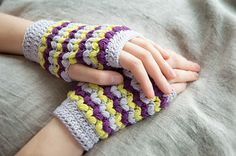 Neon Love Mitts - tangled happy. Love the mitts and the idea! That is to use scrap yarn to make these if you have a shade in between you can put any colours and it'll look good. I have some yarn at home that would be good for this...now all I need is time...