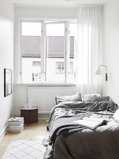 small bedroom, grey linen bedding