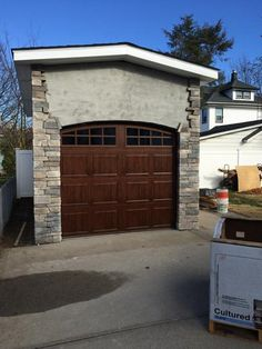 Clopay Walnut Finish Gallery Collection Garage Doors With Arched Wrought  Iron Windows And Decorative Hardware. | Garage Doors | Pinterest | Garage  Doors, ...