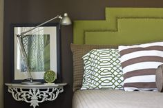 eclectic bedroom by Michelle Hinckley | houzz.com | wall mounted bedside table | industrial lamp | nailhead trim on headboard | avacado greem, browns, taupes | chocolate wall color